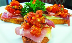 Edible's Magazine Recipe High Prosciutto on Tomato Basil Croutons